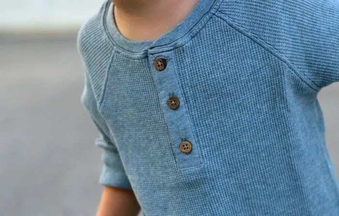 little boy in burts bees blue henley for fall