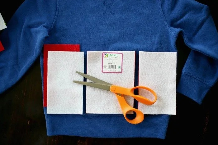 cutting-felt-over-blue-sweatshirt-2