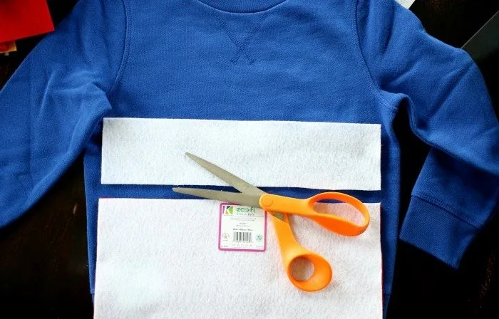 cutting-felt-over-blue-sweatshirt