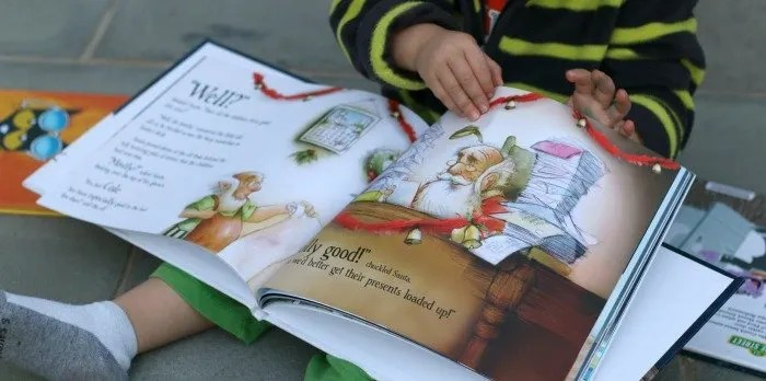 little-boy-flipping-through-christmas-put-me-in-the-story-book