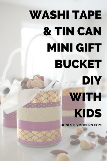 Try this quick and fun upcycled DIY that super easy to do with kids: washi tape, tin can, and a pipe cleaner for a fun and quick mini gift bucket for a friend, teacher or anyone you wish.