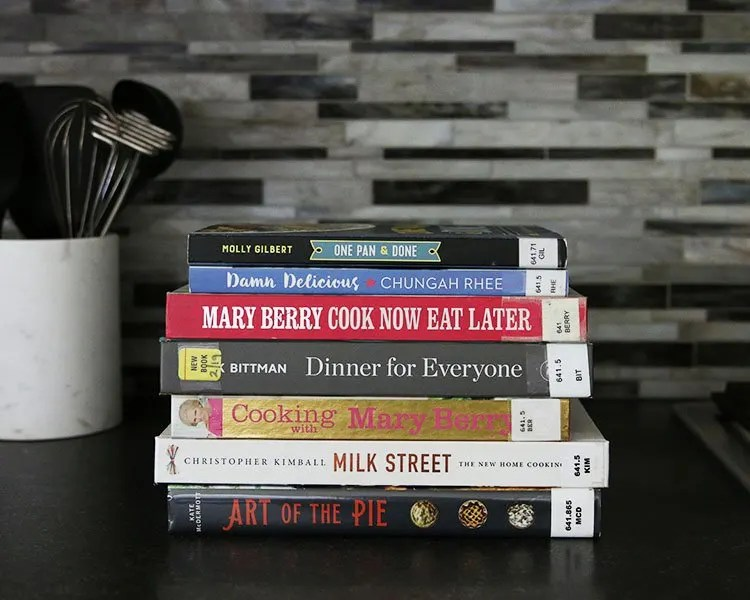 Stuck in a dinner rut and aren't sure where to search for inspiration? Try checking out a few cookbooks from your local library. You benefit from great kitchen-tested recipes, gorgeous photos to pepper your palette, and it costs you nothing. Check out these family-friendly cookbooks definitely worth checking out from your local library.| #HonestlyModern #beginnercooking #librarylove #cookbooks #recipeinspiration