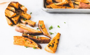 Finally fries that will love you back! These Healthy and Simple Crispy Baked Sweet Potato Fries that will satisfy your craving minus the added fat and nasties that come with deep fried foods. Pair them with homemade apple butter and your life will literally never be the same. | paleo + vegan + vegetarian + healthy + dinner + side dish + appetizer | Honestly Nourished www.honestlynourished.com