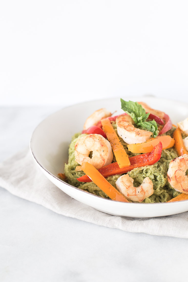 Dairy-Free Pesto Spaghetti Squash with Lemon Garlic Shrimp | A simple and flavorful weeknight recipe featuring dairy-free basil pesto and lemon garlic shrimp over nutrient-rich, low carb spaghetti squash. The perfect paleo lunch or dinner! | Honestly Nourished www.honestlynourished.com