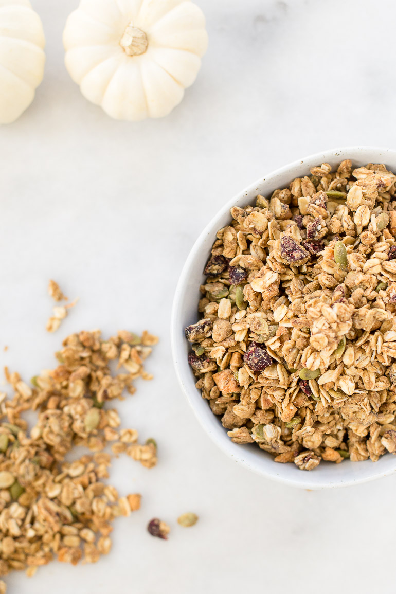 A nut-free pumpkin spice cranberry apple granola full of mega clusters galore!  It's also full of seasonal fall fruits (dried apples and cranberries), pumpkin seeds, and toasted coconut for a healthful balanced snack, breakfast or froyo topping.