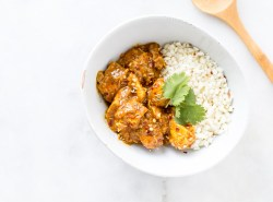 Alightened up, dairy-free recipe for one of India's beloved dishes, this slow cooker/crock pot recipe uses coconut milk and oil in lieu of butter for a healthier, paleo-friendly, gluten-free meal. Just add cauliflower or regular rice and dinner is done! | via Honestly Nourished