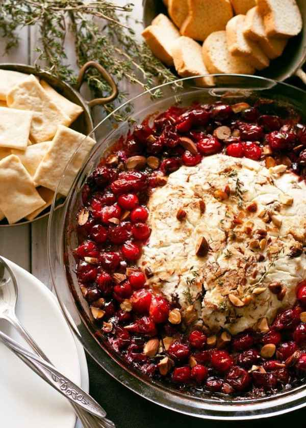 This fancy baked goat cheese roasted cranberry appetizer recipe is easier to make than it looks! It is the perfect appetizer for holiday gatherings like Thanksgiving and Christmas! | honeyandbirch.com