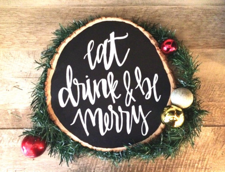 spruce tree trunk slice with eat drink and be merry written on it