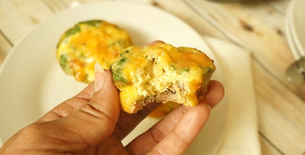 Bite out of a mini breakfast frittata