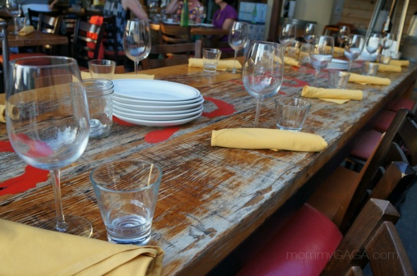 rustic dining table set with wine glasses