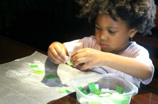 Little girl crafting with tissue paper