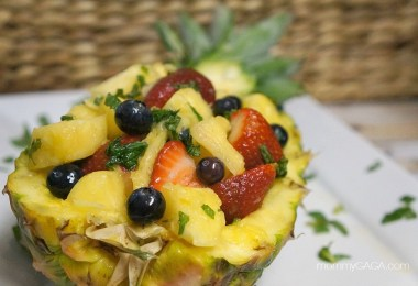 Honey Pineapple fruit salad served in a pineapple bowl