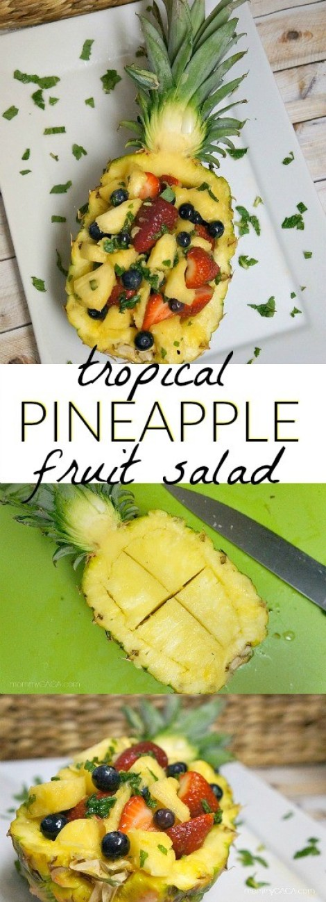 Tropical honey pineapple fruit salad with mint - served in a PINEAPPLE bowl! With strawberries, blueberries, and pineapple chunks, this is the perfect summer salad to serve at parties and events