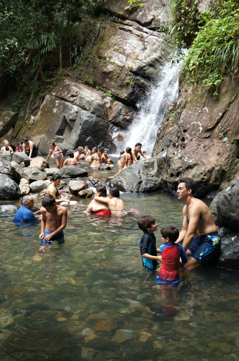 Family Travel in Puerto Rico, Lots of people enjoying La Mina Waterfall