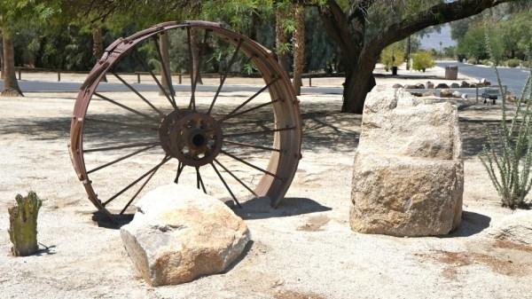 Rustic wheel at La Casa Del Zorro Desert Resort Grounds
