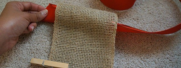 Making a burlap wall holiday card display, threading the ribbon through the top