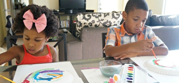 Kids painting paper plates for an Easter craft