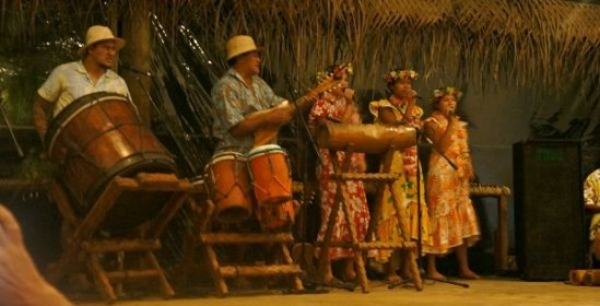 Singers and drummers prepare for the cultural show at Highland Paradise