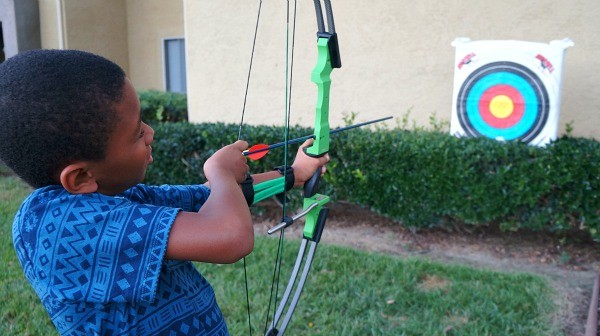 Genesis Bows kid aiming for an archery target