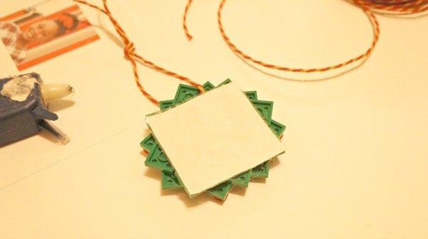 How to make a LEGO holiday wreath ornament, glue the photo to the back of the wreath