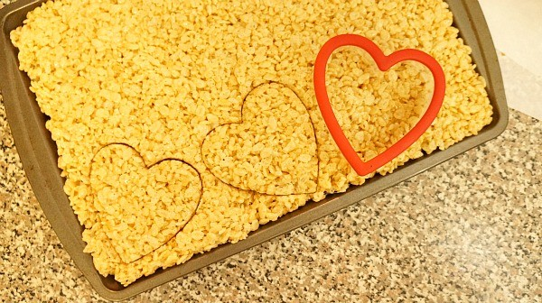 Making rice krispies heart treats with a cookie cutter