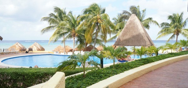 View of the adult pool and the beach at MELIA Cozumel All Inclusive Resorts