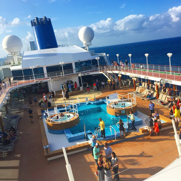 Fathom travel, view of the beautiful pool on the Adonia cruise ship at sea, deck 9