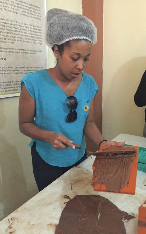 Fathom travel, guests are immersed into the chocolate making experience, Deanna Underwood is spreading chocolate into molds