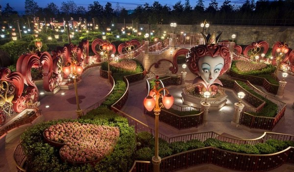 "Designed especially for Shanghai Disneyland, the Alice in Wonderland Maze is the first attraction at a Disney park themed to Tim Burton's live-action film ""Alice in Wonderland."" In the experience, guests will choose their own path as they wind through Wonderland in a maze of sculpted hedges, stone garden walls, giant flowers and whimsical sculptures on their way to the Mad Hatter's Tea Party. Along the way, they may encounter the Cheshire Cat, the White Rabbit and sculptures of characters, including the tyrannical Red Queen. (Kent Phillips, photographer)"