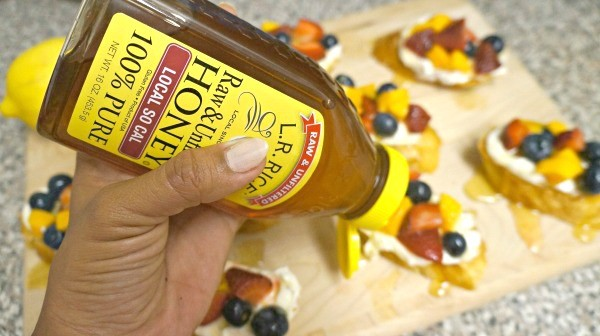 Making fresh lemon fruit bruschetta - drizzle L.R. Rice local California raw honey on top of each baguette, available at ALDI