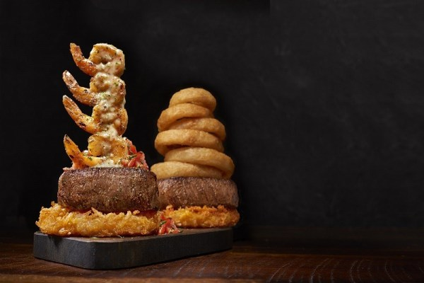 Outback Steakhouse sirloin steak tower duo with shrimp and onion rings