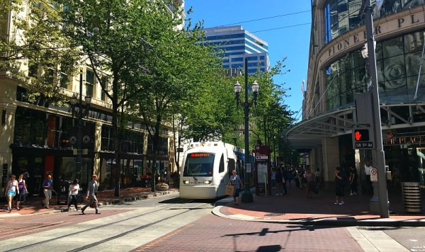 fun-things-to-do-with-kids-in-portland-oregon-trimet-max-light-rail-public-transportation-rolls-through-downtown-portland
