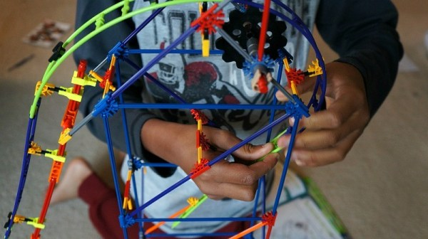 snapping-on-the-pieces-of-the-knex-wild-whiplash-roller-coaster