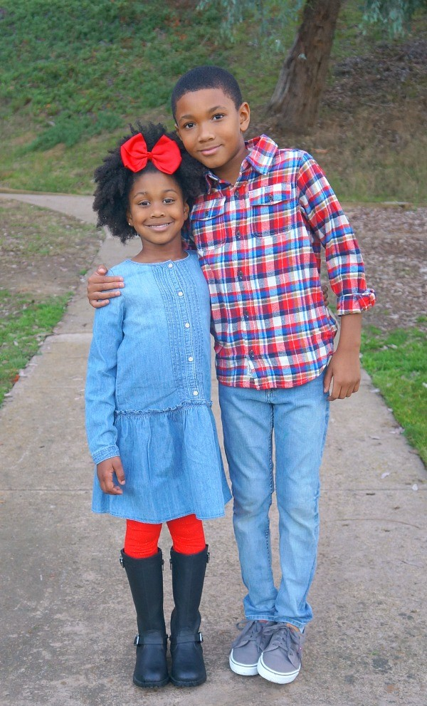 Brother and sister holiday photo shoot featuring Oshkosh B'gosh kids holiday styles