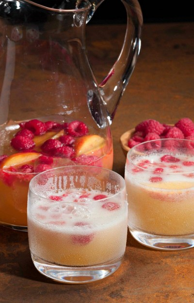 Prosecco raspberry peach punch - a sparkling and sweet adult drink!