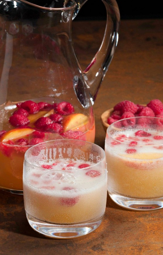 Prosecco raspberry peach cocktail - a sparkling and sweet adult drink!
