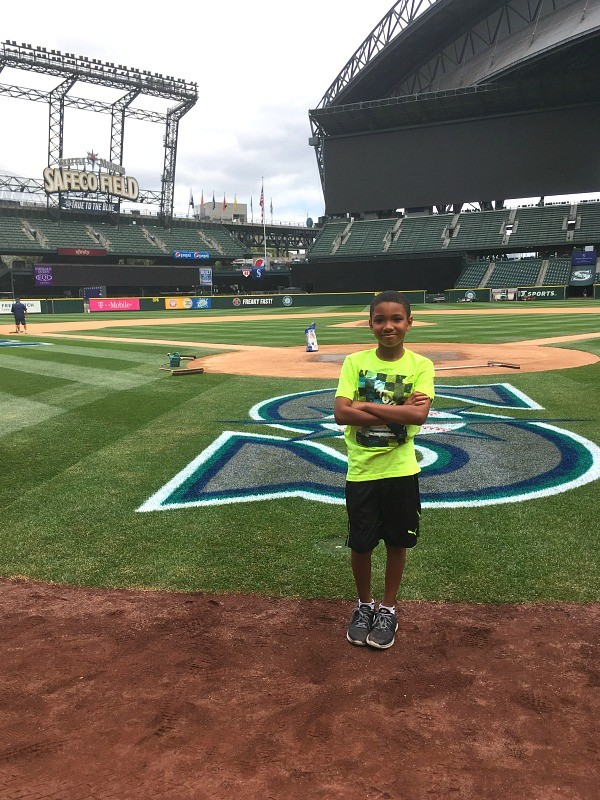 Kid on Seattle Mariners baseball field, Safeco Field Tour Review