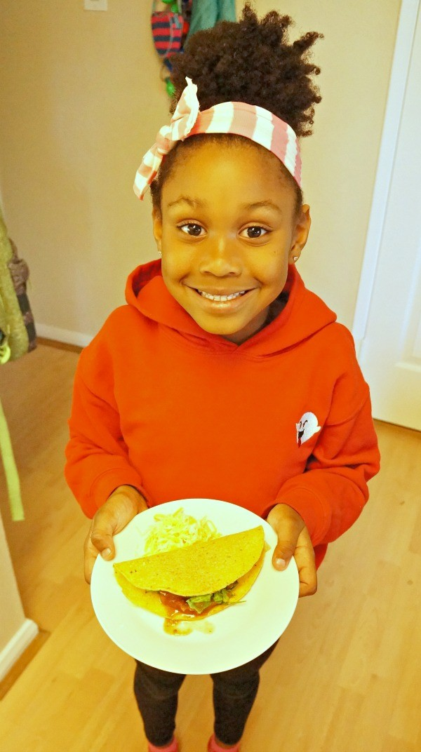 National Crunchy Taco Day, little girl with her own taco