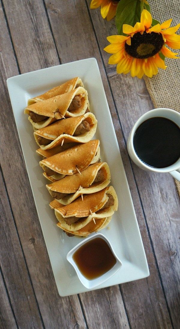 Turkey sausage pancake roll ups recipe - We've combined two brunch favorites to make these delicious and easy turkey sausage pancake roll ups, the perfect family Easter brunch recipe!