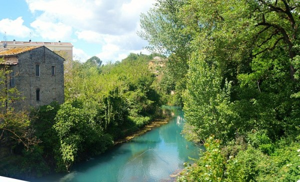 Biking past a gorgeous river in Tuscany Italy