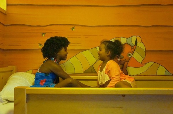 Kids playing on the bunk bed in the Wolf Den themed room at Great Wolf Lodge