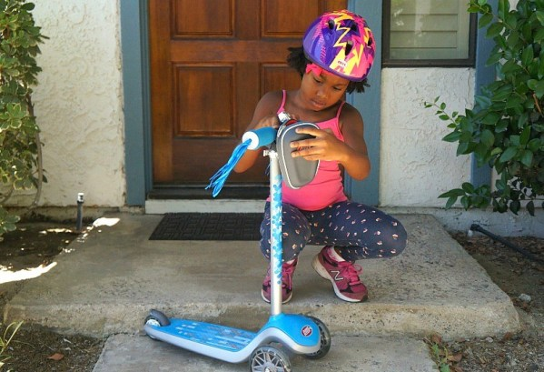 A girl and her scooter