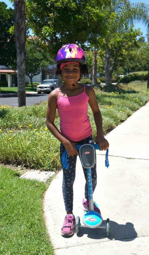 Little girl rides her custom Radio Flyer scooter