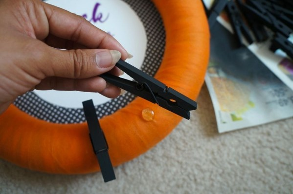 DIY Halloween candy wreath with clothes pins