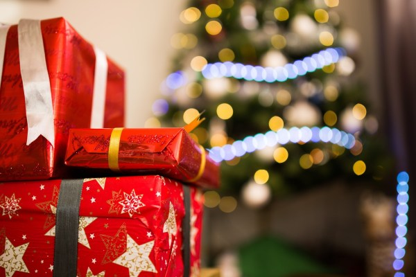 Holiday shopping tips, Christmas gifts in front of the tree