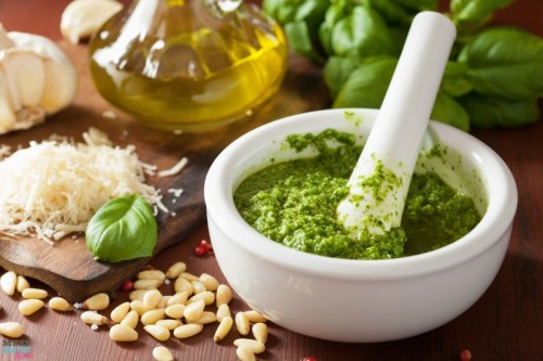 Homemade pesto sauce and ingredients