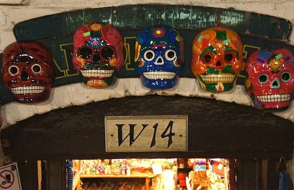 Skeleton faces line the doorway of a shop on Olvera Street Los Angeles