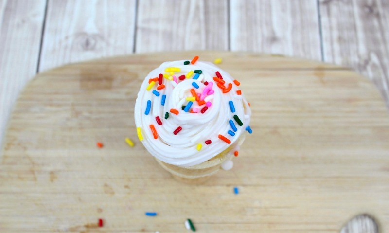 Sprinkles on top of ice-cream cone cupcake