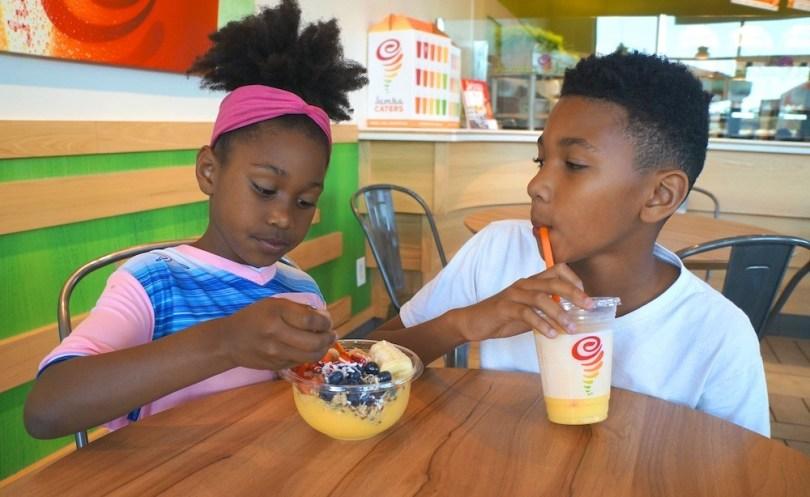 Kids enjoying Jamba Juice Mango Medley Bowl and Mango A Go-Go smoothie