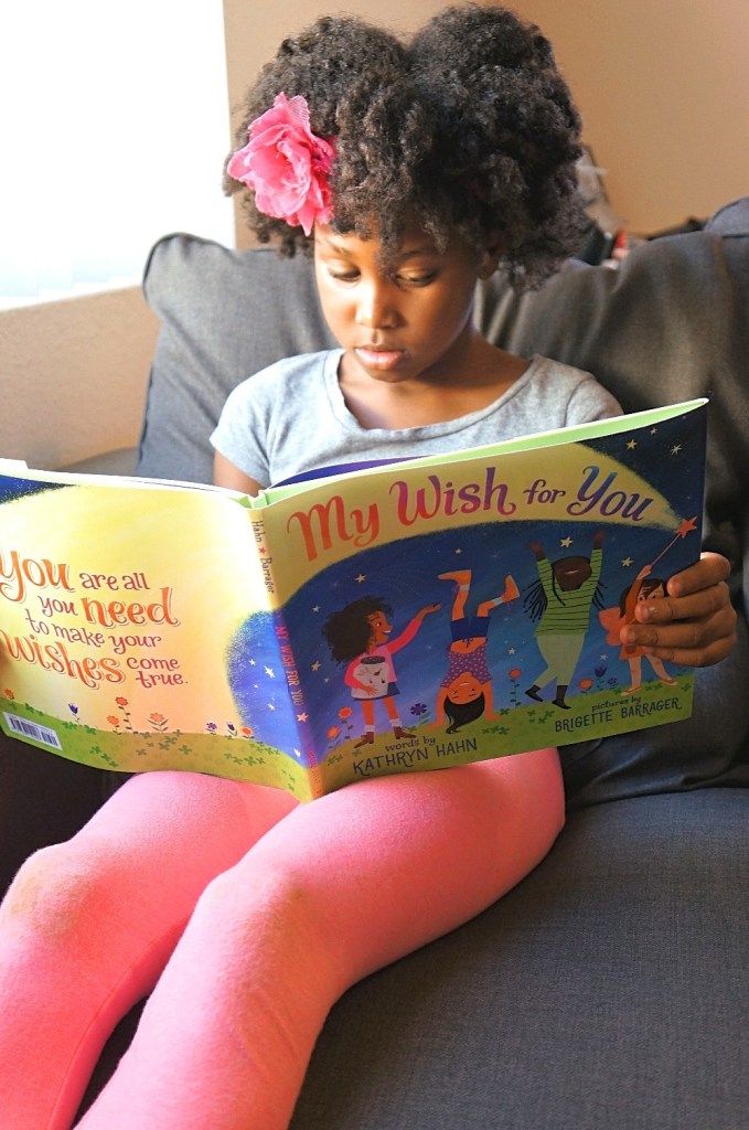 A Wish For My Daughter To Encourage Confidence and Strength In All She Does - Young girl reads My Wish For You book by Kathryn Hahn